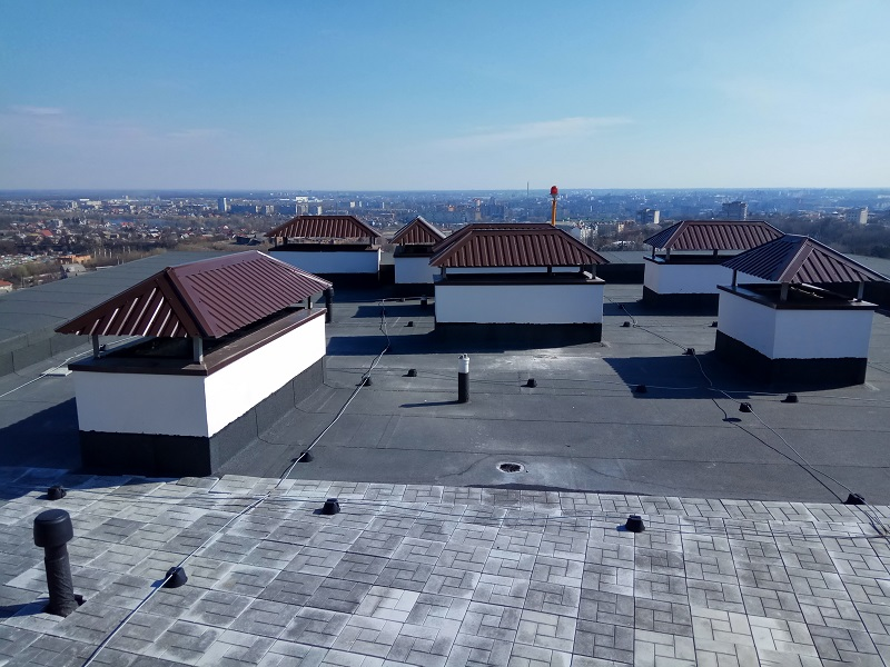 Roof of the modern building with lightning protection and ventilation system