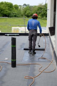 Solvent-based roof coatings