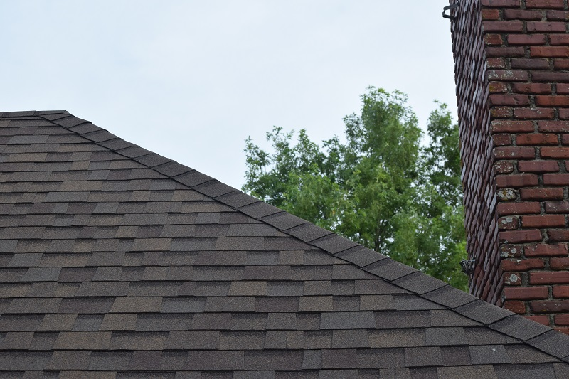 Architectural Shingles Installation At The Top Restoration