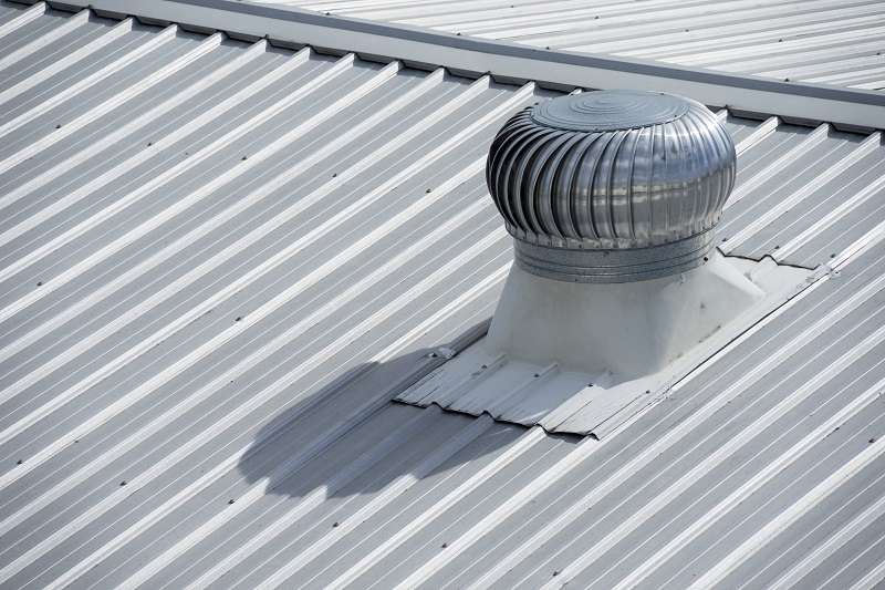 Stainless steel exhaust fan on factory roof