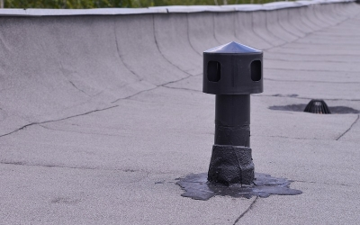 Flat roof ventilation, waterproofing ant protection . Aerator on Roofing felt. Closeup detail shoot.